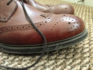 The boot style and perforations help set this shoe apart.