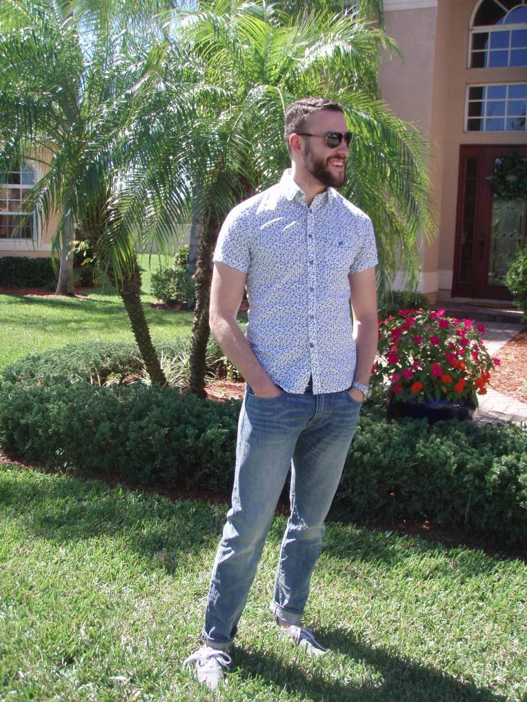 A short-sleeve shirt (or a polo) can be the perfect style pick for spring and summer. Shirt by Express. Jeans by J. Crew.  Sunglasses by Ralph Lauren.