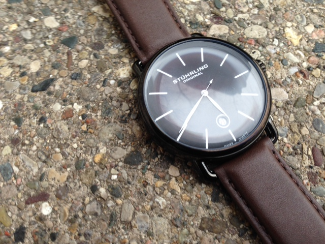 A closer look at the crisp white markings on the black dial.