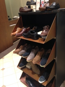 Shoes on shelves, mostly in summer suede.
