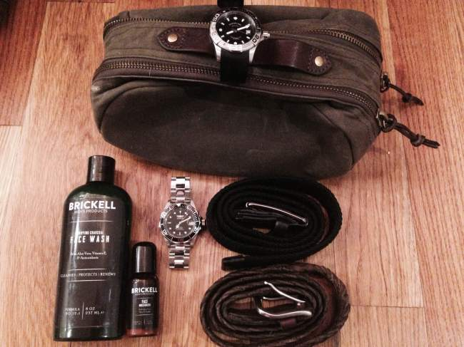 J. Crew Factory's Carson Travel Kit pictured with some other travel essentials. Rubber strap watch by Stuhrling. Stainless steel watch by Invicta. Toiletries by Brickell Men's Products.