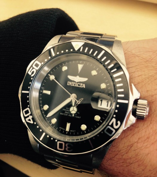 An up-close look at a versatile timepiece, the Invicta 8926 Pro Diver. Cardigan by Todd Snyder.