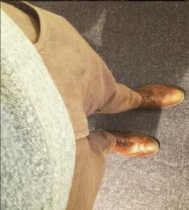 Allegheny Oak Travel Jeans from Bonobos, along with a Reigning Champ crewneck sweater and brown JCP wingtip boots for Friday's flight.