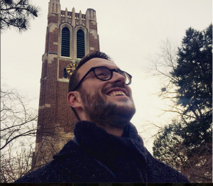 Me (Beau) posing in front, yes, Beaumont Tower on MSU's iconic campus. Overcoat by Kenneth Cole.  Scarf by J. Crew Factory. Glasses by Warby Parker.
