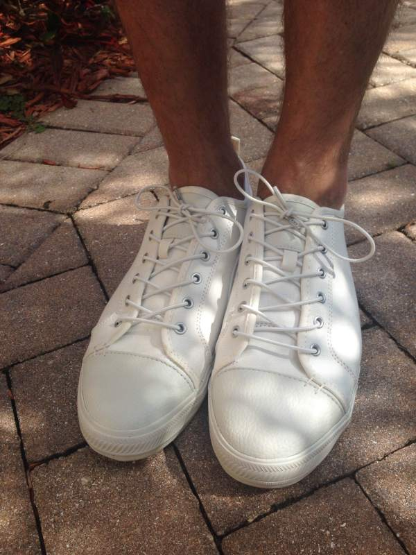 Just one shoe option to make things more bearable on a hot summer's day. White sneakers by GREATS Brand.