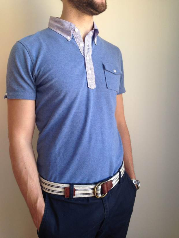 Washed polo by Michael Bastian x Uniqlo. Navy chinos by Bonobos. Striped webbed belt by J. Crew Factory. Silver dive watch by Invicta.