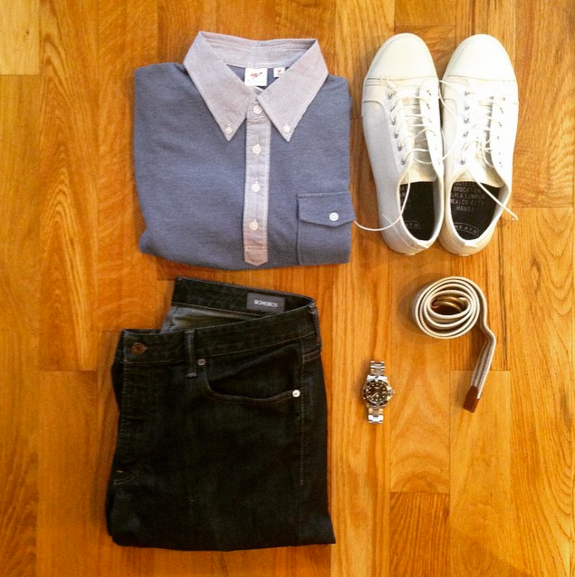 One of the many ways this polo can be styled. Slim dark denim by Bonobos. White sneakers by GREATS. Striped webbed belt by J. Crew Factory. Silver dive watch by Invicta.