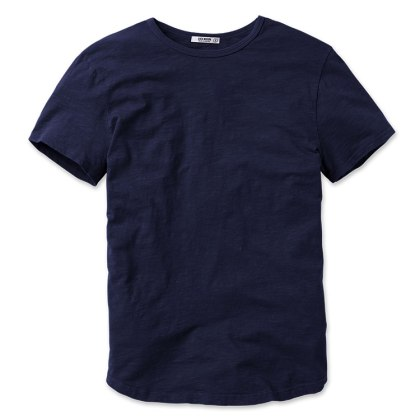 Slouchier collar, rounded shirttail and a deep navy color — definitely not the standard crewneck.