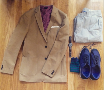 Slim-Fit Khaki Travel Jacket by Combat Gent. Washed red henley by GAP. Light grey chinos by Bonobos. Navy sneakers by GREATS Brand. Striped socks by Richer Poorer. Brown leather watch by Stuhrling.