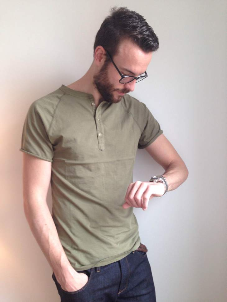A trim fit and vintage details make this short-sleeve henley from Pistol Lake a winner. Glasses by Warby Parker. Stainless steel dive watch by Invicta. Dark denim by Mott & Bow.