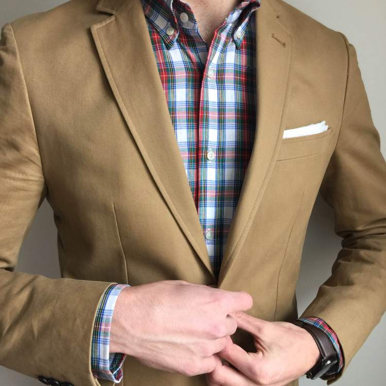An in-person review of Combat Gent's Slim-Fit Khaki Travel Jacket. Size shown: 38L. Spring Plaid shirt by Gustin. Pocket square by Banana Republic. Brown leather watch by Stuhrling. Photo credit: Liz Todd.