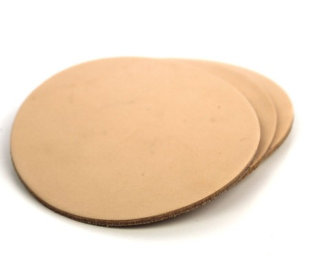 Durable leather makes for a very nice coaster from which to enjoy a hearty adult beverage.