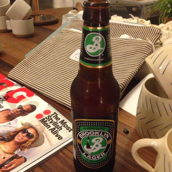 Recharging slightly during Fashion Week: Men's with a cold one from the esteemed Brooklyn Brewery.