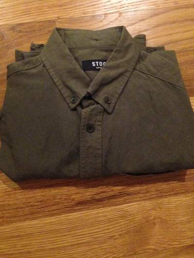 The Sage Linen Buttondown in person, fresh out of the box. An excellent summer staple.