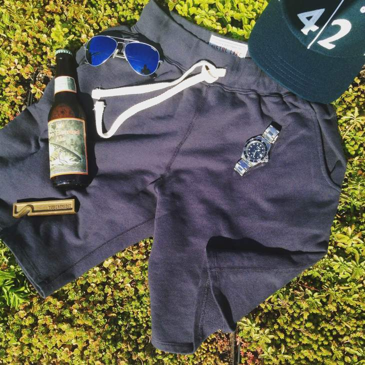 Perhaps the best representation of the kind of gear you should have on-hand for the weekend. French Terry Sweatshorts by Pistol Lake. Stainless steel dive watch by Invicta. Sunglasses by Randolph Engineering. Vintage ballcap by Goorin Brothers. Brass bottle opener by Owen & Fred. Two-Hearted Ale by Bell's Brewing.