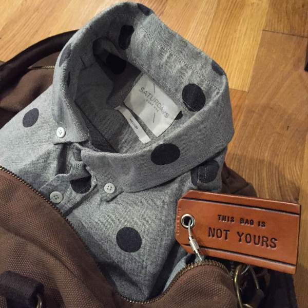 The perfect shirt for a night out, and the perfect bag for cross country travel. Polka dot short-sleeve Oxford by Saturdays NYC. Stowaway Weekender Bag by Navali.
