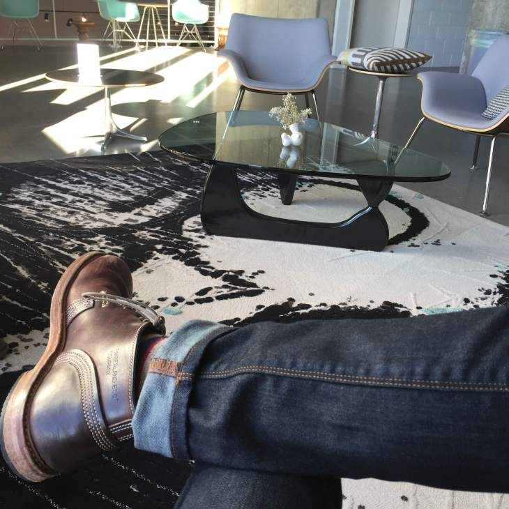 The Urban Institute for Contemporary Arts features a relaxing loft space filled with Herman Miler pieces. Slim denim by Mott & Bow. Leather chukka boots by Timberland. Striped socks by American Trench.
