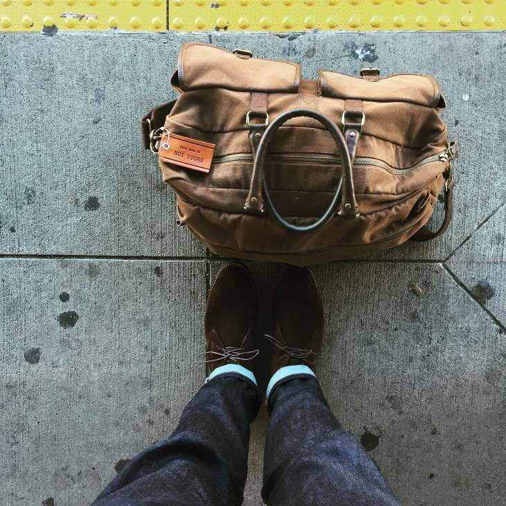 Hitting the road again. Slim denim by Mott & Bow. Chocolate Suede Scout Boots by Thursday Boots. Stowaway Weekender Bag by Navali. Leather luggage tag by Owen & Fred.