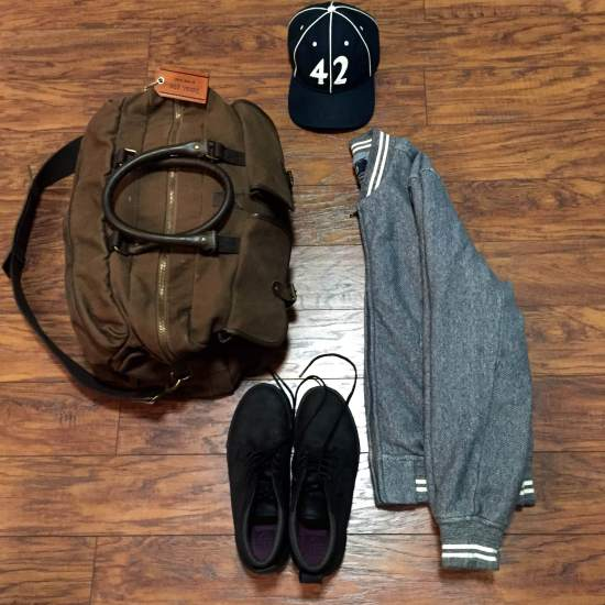 One way to style these sneakers -- with a solid baseball jacket (via Grayers), a vintage ballcap (via Goorin Brothers) and a dependable weekender bag (by Navali).