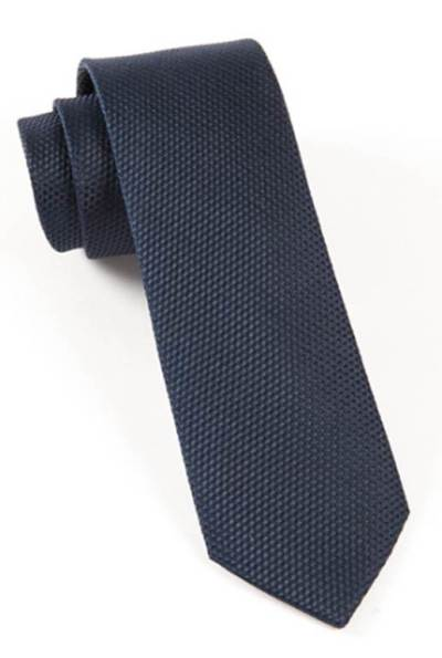 A tie with some visual interest to complement the birdseye weave of the suit.