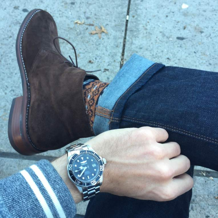 Pair these boots with everything from slim denim to chinos (don't forget a pop of color in your sock game). Baseball jacket by Grayers. Stainless steel dive watch by Invicta. Slim denim by Mott & Bow.