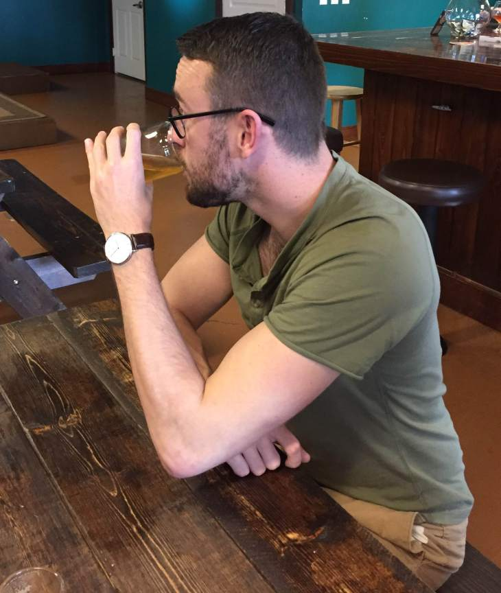 Sipping on a great brew at the nice Point Ybel Brewing Company in Fort Myers. Olive short-sleeve henley by Pistol Lake. Classic Bristol leather watch by Daniel Wellington. Glasses by Warby Parker.