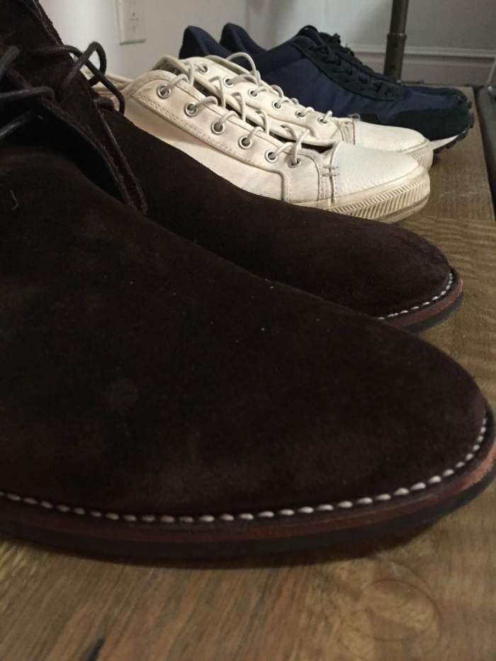 The shoes I'm bringing with me. From front to back: Chocolate Suede Scout Chukka by Thursday Boot Company. White Wilson sneakers and navy Rosen runners from GREATS Brand.