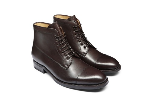 A lovely shade of dark brown and a refined captoe merge with a hand-stitched rubber outsole.