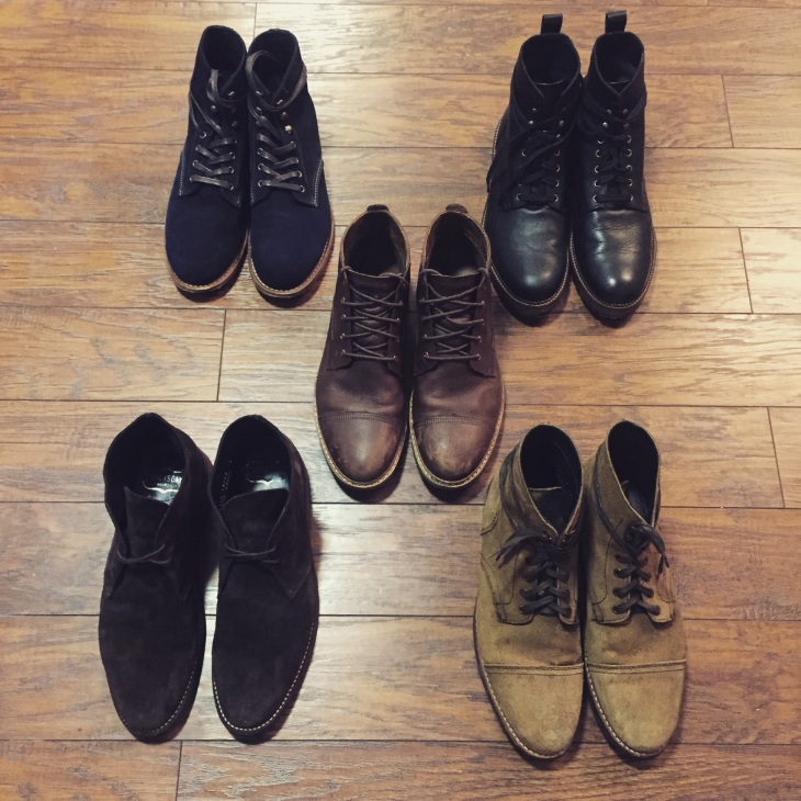 Pick a boot, any boot. Back left corner: Wolverine 1000 Mile in Navy Suede. Back right corner: Timberland Britton Hill Waterproof Moc Toe. Center: Timberland West Haven Chukka. Front left: Thursday Boot Company Chocolate Suede Scout Chukka. Front right: Thursday Boot Company Roughout Captain Boot.