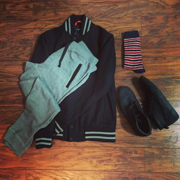 Cozy, versatile and stylish. Collegiate Bomber by JackThreads. Nomad French Terry Sweatpants by Bonobos. Striped socks by American Trench. Black chukka sneakers by Reef.