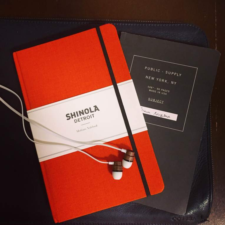 Just enough room in this Issara leather laptop sleeve to carry some nice essentials. Orange notebook by Shinola. Grey notebook by Public Supply. Wooden earphones by Woodbuds.