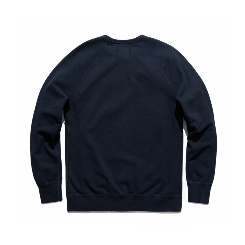 A view from the back of the Reigning Champ crewneck sweatshirt, featuring raglan should stitching.