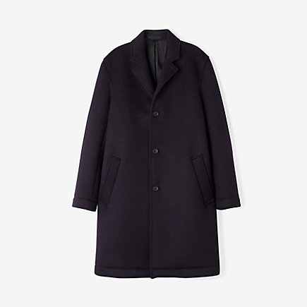 All sorts of weatherproof features found their way into this minimal navy topcoat. Worth the price?