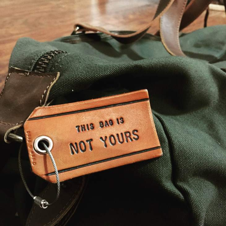 Taking the Mt. Drew Duffle from United By Blue around the country. Leather luggage tag by Owen & Fred.