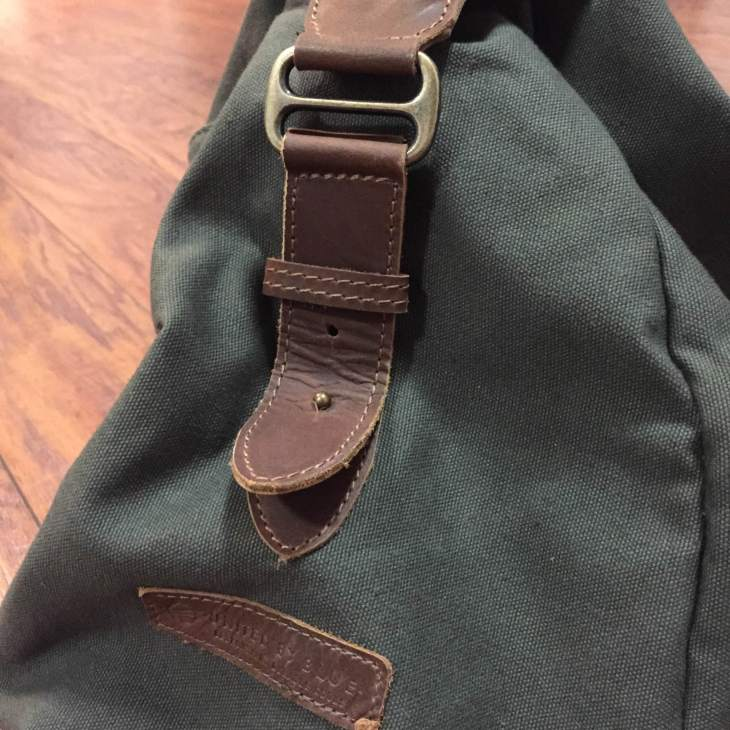 Brass hardware pairs well with the dark brown genuine leather straps.