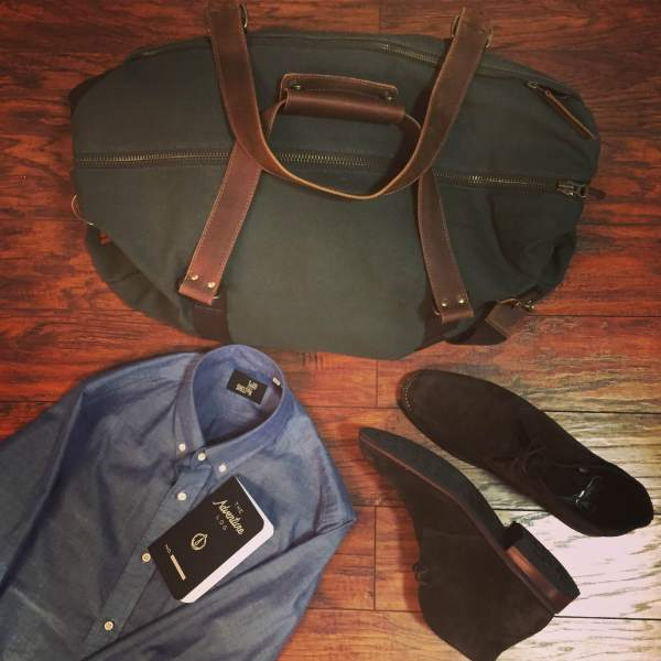 Ready to hit the road with the Mt. Drew Duffle. Natural chambray shirt by Todd Shelton. Chocolate Suede Scout Chukka Boots by Thursday Boot Company. Adventure Log by Word Notebooks.
