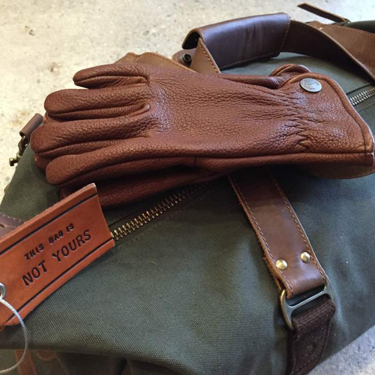 Fit to carry all kinds of seasonal accessories. Leather luggage tag by Owen & Fred. Buffalo Bobber Leather Gloves by Iron & Resin.