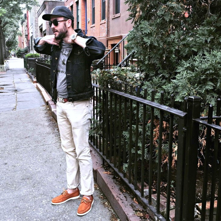 Ready for some Sunday brunch and brownstone envy. Denim jacket by American Apparel. Printed graphic tee and Flat Wool Cap by Bridge and Burn. Slim Light Mercer Denim by Mott & Bow. Cooper Boat Shoes in Caramel Nubuck by Jack Erwin. Waterbury Chrono by Timex x Red Wing. Sunglasses by Spine Optics. Striped webbed belt by J. Crew.