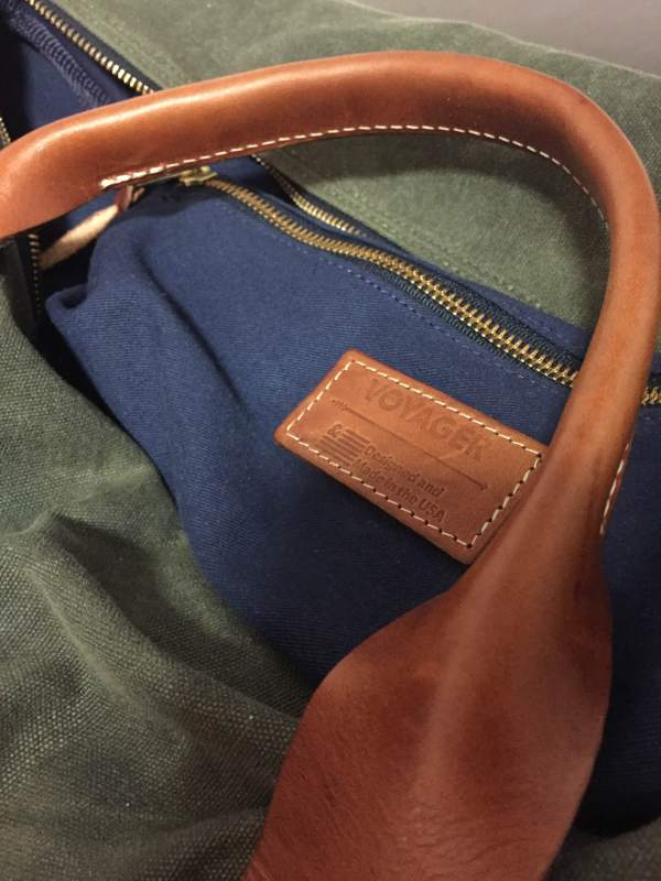 A navy twill interior and army green waxed canvas are complemented by leather handles from Wickett & Craig.