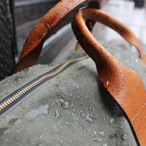A look at the waterproof qualities of the waxed canvas, plus the beautiful leather handles via Wickett & Craig.