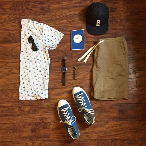 Can't go wrong with a printed tee and slim shorts in warm weather. Stringer Dune Shorts and Flat Wool Cap by Bridge & Burn. Printed T-shirt by J. Crew. Sneakers by The Hill-Side. Brown leather watch by MVMT Watches. Field Guide by Wildsam. Brass bottle opener by Owen & Fred.