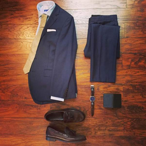 This past weekend's wedding outfit laid out and ready to go. Navy Thompson suit by J. Crew Factory. Blue shirt by Twillory. Cotton tie and tipped pocket square by Ties.com. Brown leather watch by MVMT Watches. Heritage Tassel Loafers by Sebago. Wallet from the latest SprezzaBox.