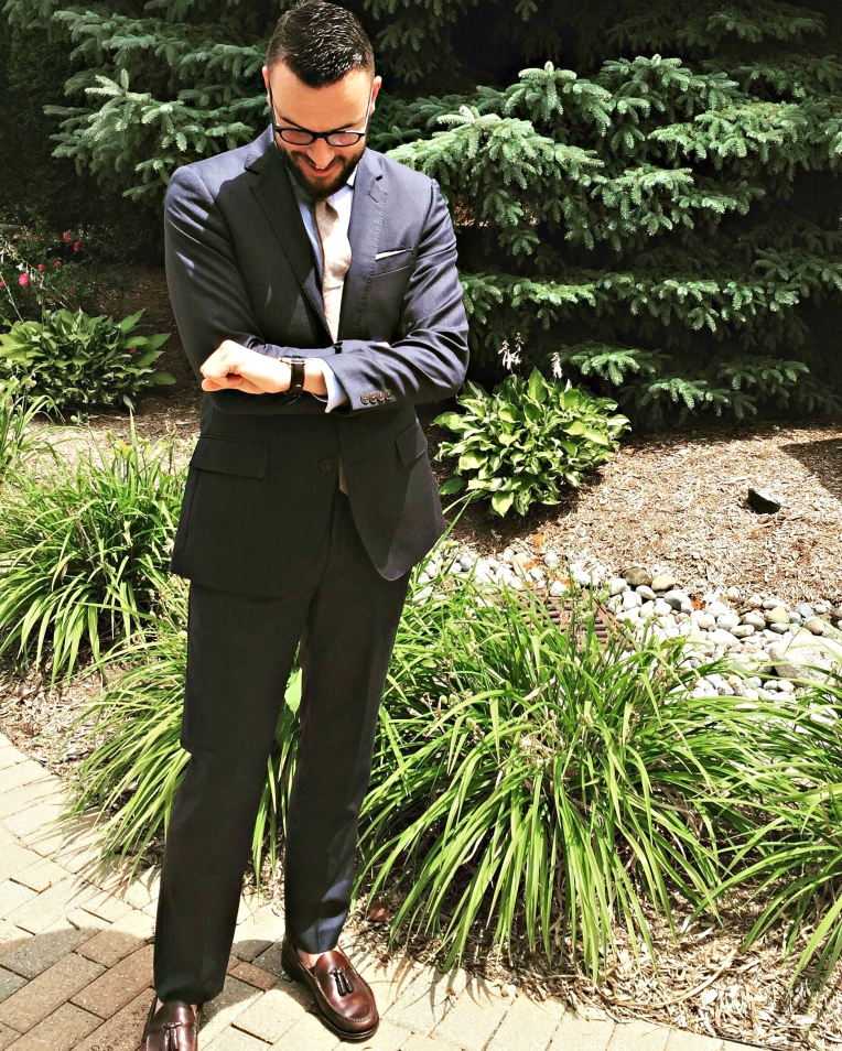 Dressed in style for a summer wedding. Blue shirt by Twillory. Cotton tie by Ties.com Thompson Navy suit by J. Crew Factory. Glasses by Warby Parker. Heritage Tassel Loafers by Sebago. Brown leather watch by MVMT Watches.