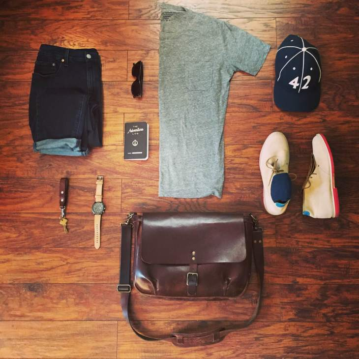 A casual, comfortable Friday travel outfit. Slim Mailbag by Satchel & Page. T-shirt in Heather Grey and Colorblocked Socks by Richer Poorer. Slim Staple Denim by Mott & Bow. Tan Suede Chukkas by Blu Kicks. Hawker Hunter II Watch by AVI-8. Vintage ballcap by Goorin Brothers. Leather lanyard by Tanner Goods. Sunglasses by Steven Alan Optical. Adventure Log by Word Notebooks.