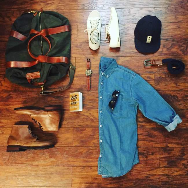 Packed up to hit the road. Denim Shirt by JackThreads. Voyager Waxed Weekender by Owen & Fred. Natural Diplomat Boots by Thursday Boots. Legend Sneakers by SeaVees. Hudson Belt by Arcade Belt Co. Flat Wool Cap by Bridge & Burn. Waterbury Chrono from the Timex x Red Wing collab.