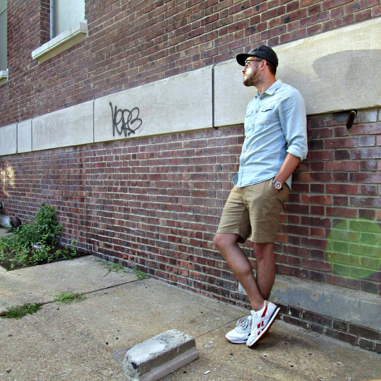 Searching high and low for cool sights in Asbury Park. Denim Shirt by JACHS NY. Stringer Dune Shorts by Bridge & Burn. Daily Classic Nylon Sneakers by Reebox x JackThreads. Mod Watch by Timex x Todd Snyder. Sunglasses by Nautica. Flat Wool Cap by Bridge & Burn.