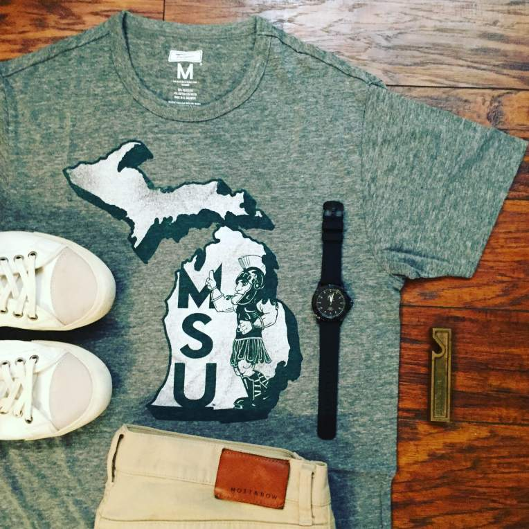 A vintage-inspired tee and a tough team watch help add a touch of style to an athletics-inspired outfit.