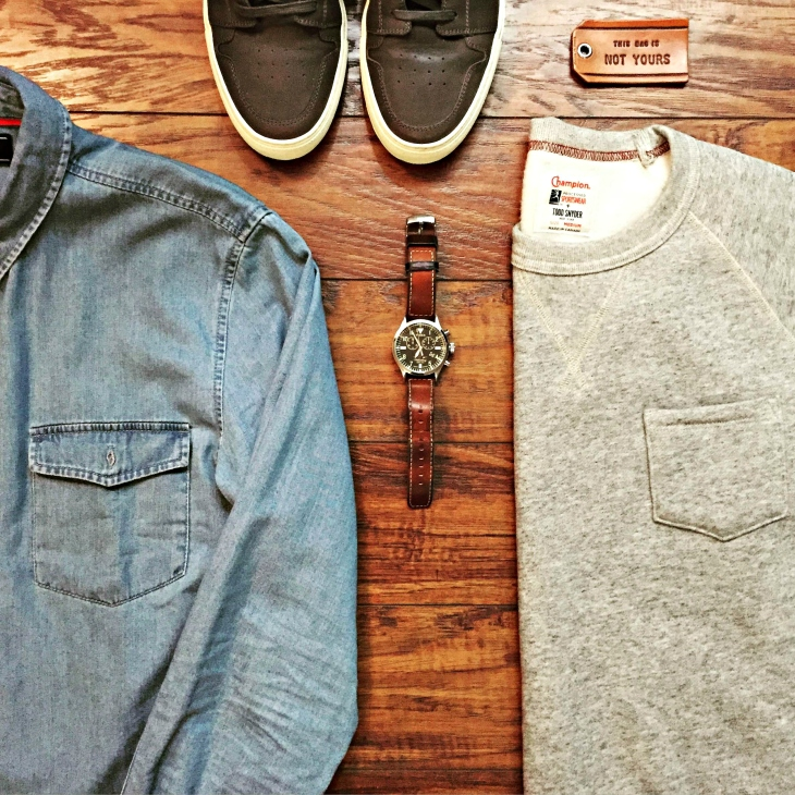 Casual Sunday brunch gear, anyone? Slim-Fit Chambray Shirt by Forever21 Men. Pocket Sweatshirt by Todd Snyder x Champion. Royale Court Sneakers by GREATS Brand. Waterbury Chrono by Timex x Red Wing Heritage.