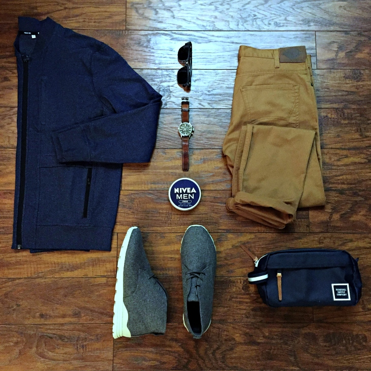 Gear for the office, a flight and Florida style. Crosstown Bomber by Public Rec. Slim-Fit Tapered Leg 5-Pocket Pants by Dickies. Strayhorn Mid Sneakers by JackThreads. Waterbury Chrono by Timex x Red Wing Heritage. Sunglasses by Nautica. Chapter Travel Kit by Herschel Supply Co.