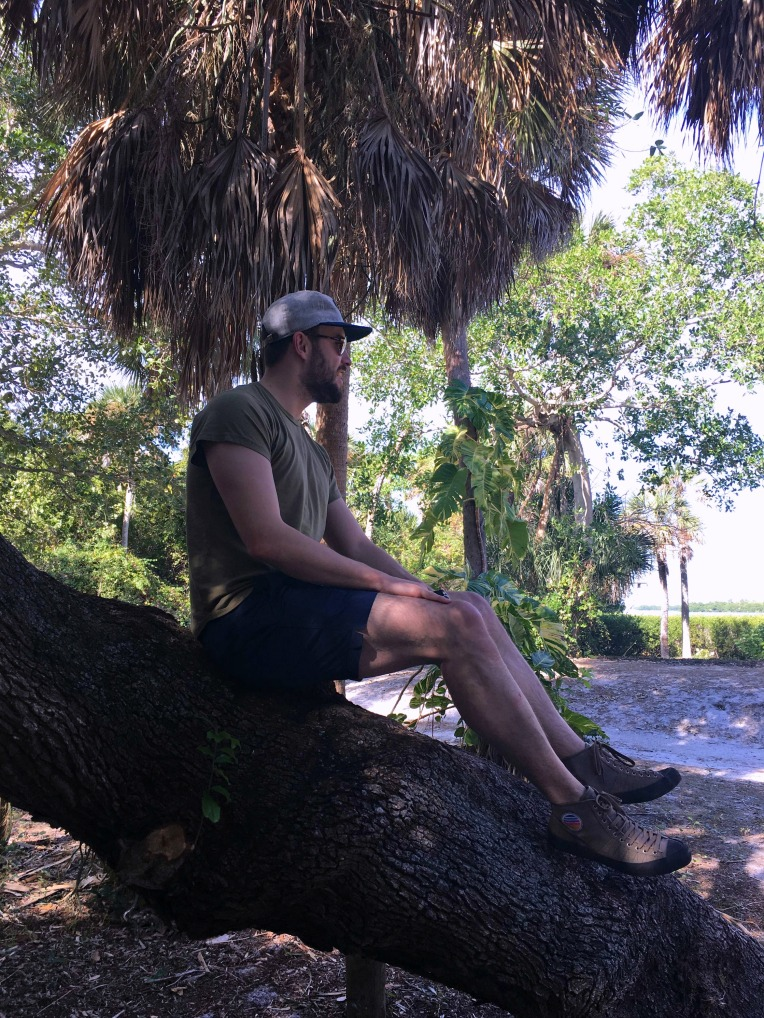 Looking out on a lovely day at Cayo Costa. Brando T-Shirt by Barking Irons. Swim Trunks by JackThreads. Gratton Sneakers by Fronteer. Expedition watch by Timex. Explorer's Cap by Huckberry. Runaway Aviators by MVMT Watches.